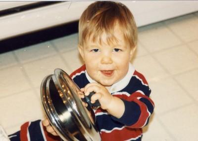 Baby playing pot lids